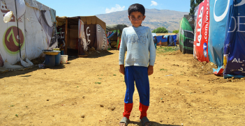 A refugee child in the camp at Qab Elias, Bekaa Valley, Lebanon, near the Syrian border. Image Credit: Flickr (CAFOD Photo Library) Creative Commons.