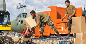 Philippines military members load relief aid. Image credit: Flickr (Department of Foreign Affairs and Trade) Creative Commons.