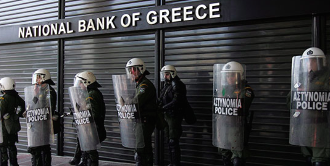 Policemen guard the shuttered National Bank of Greece. Photo Credit: Flickr (Global Panorama) Creative Commons.