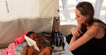 Angelina Jolie visits a boy who lost a limb in the Haitian earthquake. Photo Credit: Flickr (UNHCR UN Refugee Agency) Creative Commons.