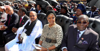 President Mugabe and his Wife Grace Mugabe await his inauguration in 2014. Photo Credit: Flickr (GovernmentZA) Creative Commons.