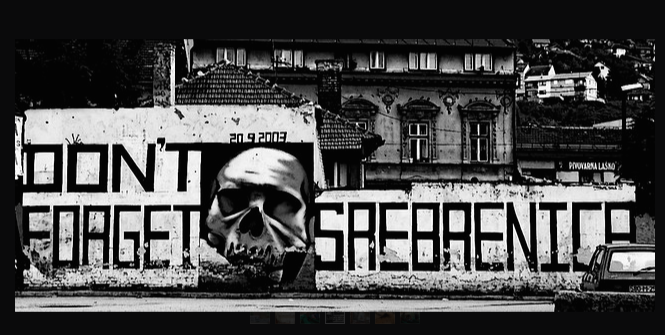 A photo taken Srebrenica of graffiti reminding people not to forget the massacre. Photo Credit: Flickr (Never-ending September) Creative Commons.