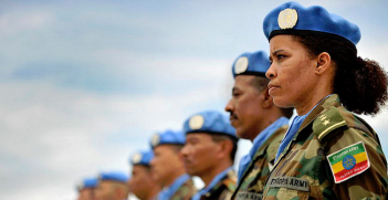 A female member of the Ethiopian battalion of the United Nations Mission in Liberia (UNMIL) joins the military observers in a parade to receive the medals in recognition of their contribution to the mission. Photo Credit: Flickr (UN Photo/Christopher Herwig) Creative Commons