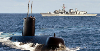South African Navy submarine SAS Charlotte Maxeke cuts through the surface ahead of Type 23 frigate HMS Portland during an exercise off the coast of South Africa. Photo Credit: Flickr (Defence Images) Creative Commons