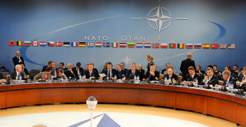 U.S. Defense Secretary Robert M. Gates and other members of NATO Ministers of Defense and of Foreign Affairs meet at NATO headquarters. Photo Source: Wikimedia Commons. Creative Commons.