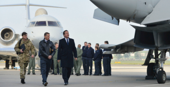 David Cameron looks at Typhoon during visit to RAF Northolt. Photo Source: (Flickr) Number 10. Creative Commons