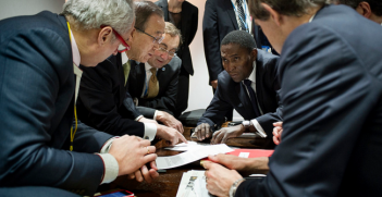 Recent discussions on the text, one hour before it is presented to the committee of Paris, Ban Ki Moon and the UN team, and François Delattre, Ambassador, Permanent Representative of France to the United Nations. Photo Source: COP 21 (Flickr). Creative Commons.