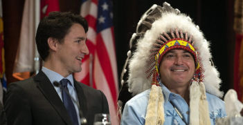 Justin Trudeau and AFN national chief Perry Bellegarde talk before the beginning of the Assembly of First Nations Special Chiefs Assembly in Québec.