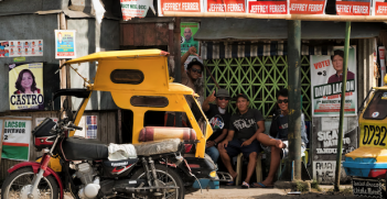 Pedicab waiting station surrounded by election material in Silay City, Philippines. Photo source: Brian Evans (Flickr). Creative Commons.