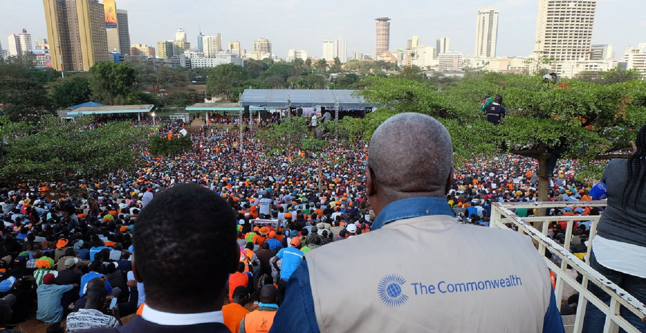 An international observer looks over a crowd gathered for the 2017 Kenya election.
