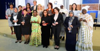 Former US Secretary of State John Kerry with the winners of the 2015 Women of Courage