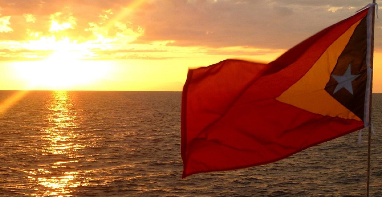Timorese Flag At Sunset over the Timor Sea