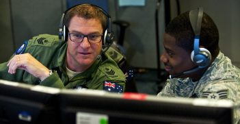 Royal Australian Air Force Flight Sgt. Sean Bedford (left), Australian Space Operations Centre space duty technician, New Norcia, Australia, ., and U.S. Air Force Senior Airman Frederick Riggans-Huguley, 603rd Air and Space Operations Center space duty technician, Ramstein Air Base, Germany, analyze air missile defense systems inside the Combined Air and Space Operations Center-Nellis during Red Flag 14-1 Feb. 5, 2014, at Nellis Air Force Base, Nev. Space duty technicians direct air missile ballistic warnings and provide communication to combat search and rescue teams.