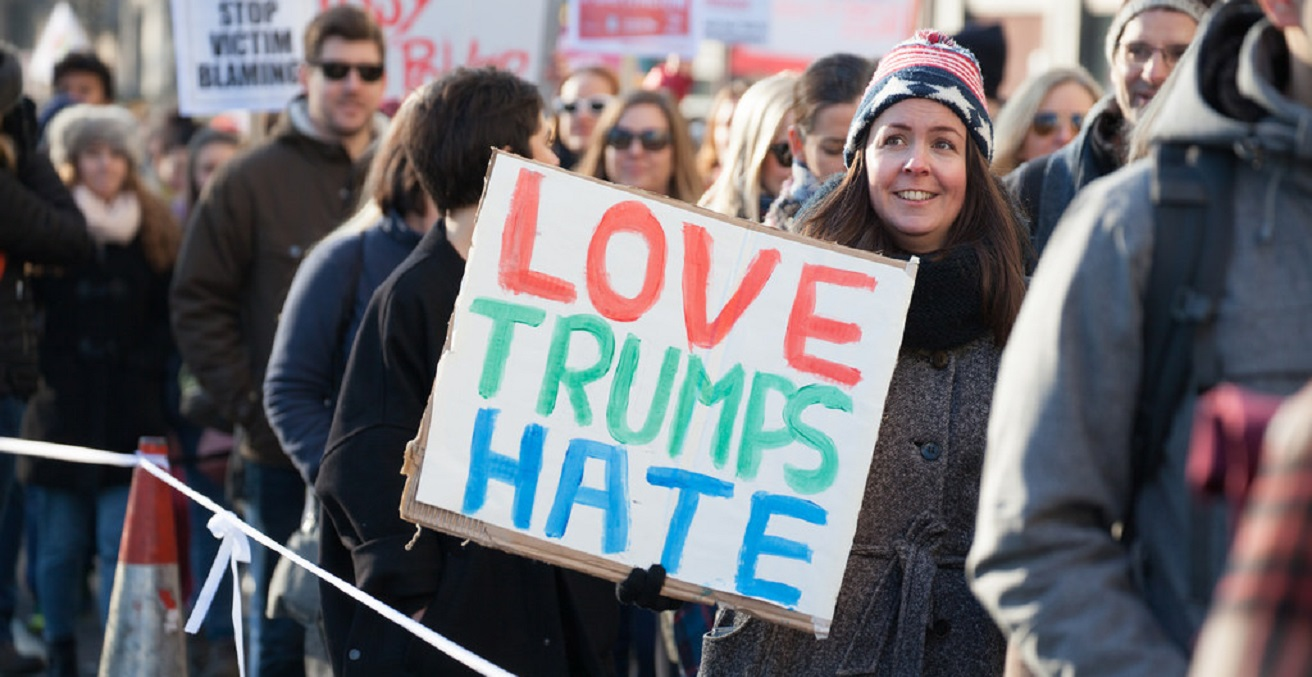 A woman protests against Trump