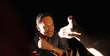 Malaysian opposition leader Anwar Ibrahim greets his supporters during a rally dressed in mourning black gathered to denounce elections which they claim were stolen through fraud by the coalition that has ruled for 56 years. in Penang May 11 2013. Pix Firdaus Latif