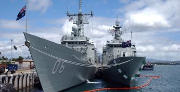 040628-N-6551H-018 Pearl Harbor, Hawaii (June 28, 2004) - The Royal Australian Navy Adelaide-class frigate HMAS Newcastle (FFG 06) and the Anzac-class HMAS Parramatta (FFH 154) are moored pier side at Naval Station Pearl Harbor as they await the beginning of the multi-national maritime exercise Rim of the Pacific 2004 (RIMPAC). RIMPAC is the largest international maritime exercise in the waters around the Hawaiian Islands.  This years exercise will include eight participating nations; Australia, Canada, Chile, Japan, Peru, South Korea, Britain and the United States. RIMPAC is intended to enhance the tactical proficiency of participating units in a wide array of combined operations at sea, while enhancing stability in the Pacific Rim region. U.S. Navy photo by Photographer's Mate 1st Class Michelle R. Hammond (RELEASED)