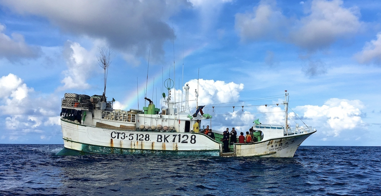 The Australian Fisheries Management Authority and the US Coast Guard board a Taiwanese boat in the Palau exclusive economic zone in 2016. Source: Sara Mooers, Coast Guard News, Flickr