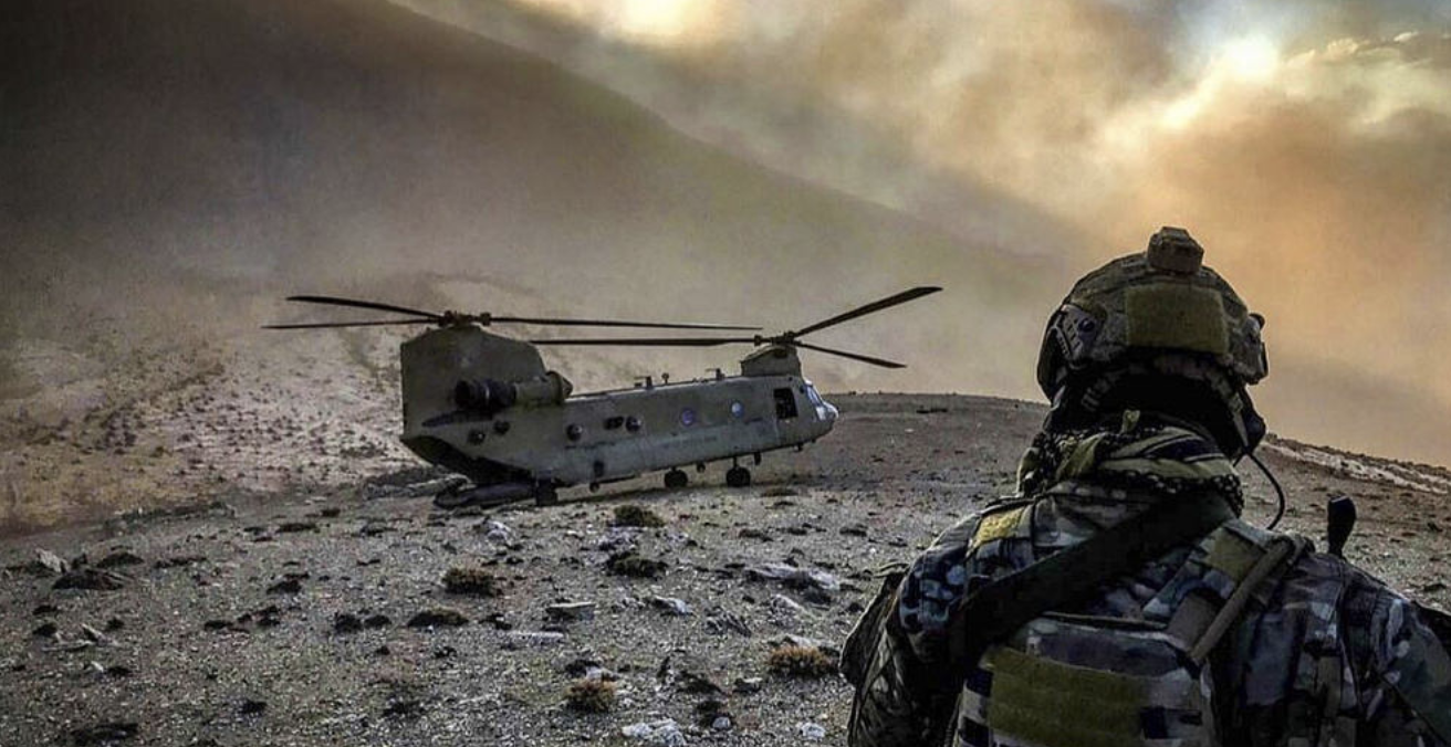 An airman observes an Army CH-47 Chinook helicopter at an undisclosed location in Afghanistan. Will US soldiers finally be going home? Source: US Army