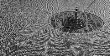 Mirrored Heliostats reflect and concentrate desert sunshine on a tower at the Ivanpah solar power station in the Mojave Desert, California. Source: Jamey Stillings on Flickr