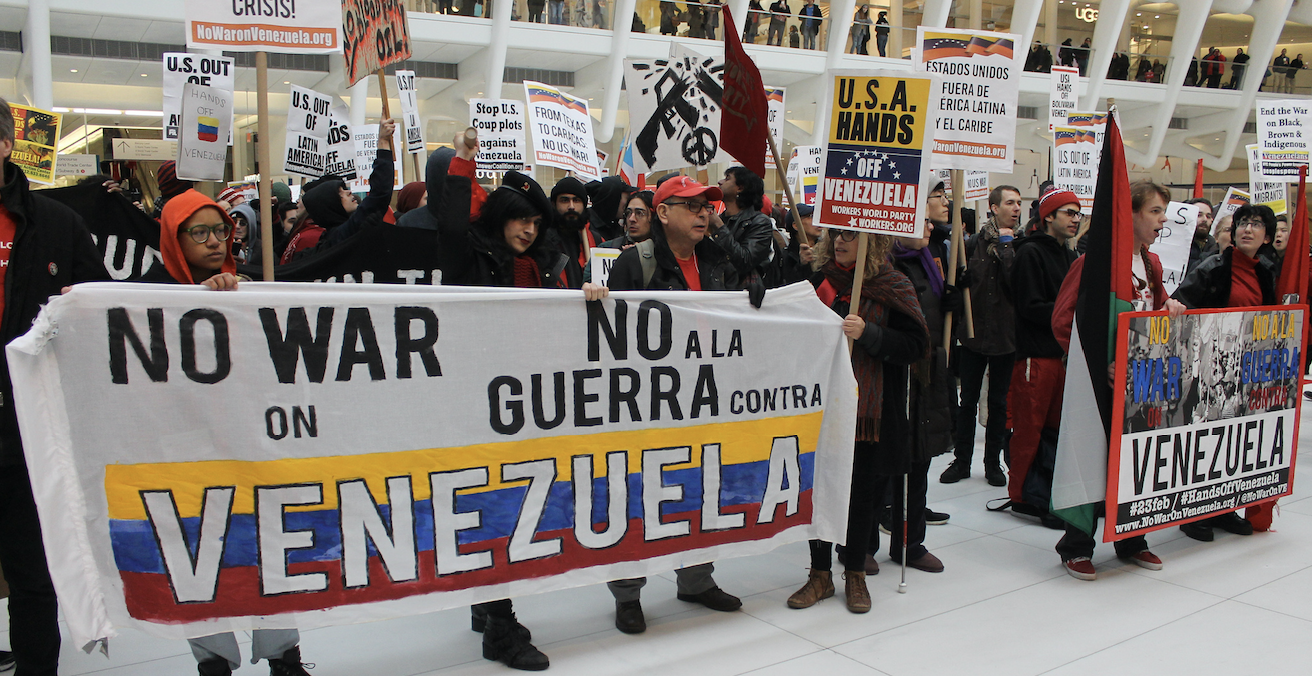 Protesters against foreign intervention in the Venezuelan crisis occupy the World Trade Center in New York on 23 February. Source: Joe Catron, Flickr