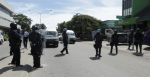 Solomon Islands police close the main road in the central business district of Honiara. Photo: Sukwadi Media
