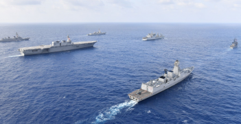 The U.S. Navy guided-missile destroyer USS William P. Lawrence (DDG 110), upper left, transits international waters of the South China Sea with the Indian navy destroyer INS Kolkata (D 63) and tanker INS Shakti (A 57); the Japan Maritime Self-Defense Force helicopter carrier JS Izumo (DDH 183) and destroyer JS Murasame (DD 101); and the Republic of the Philippines navy patrol ship BRP Andres Bonifacio (PS 17). (U.S. Navy photo courtesy of the Japan Maritime Self-Defense Force/Released)