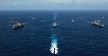 Naval ships in formation, including Indian and Australian vessels. Source: Wikimedia Commons http://bit.ly/2JOw8EO