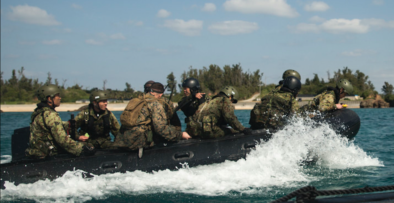 US Marines and Japanese Ground Self-Defense Force navigate the seas in a Combat Rubber Raiding Craft at Kin Blue, Okinawa, Japan, March 3, 2016. Source: US Marines gov website http://bit.ly/2ShucHC