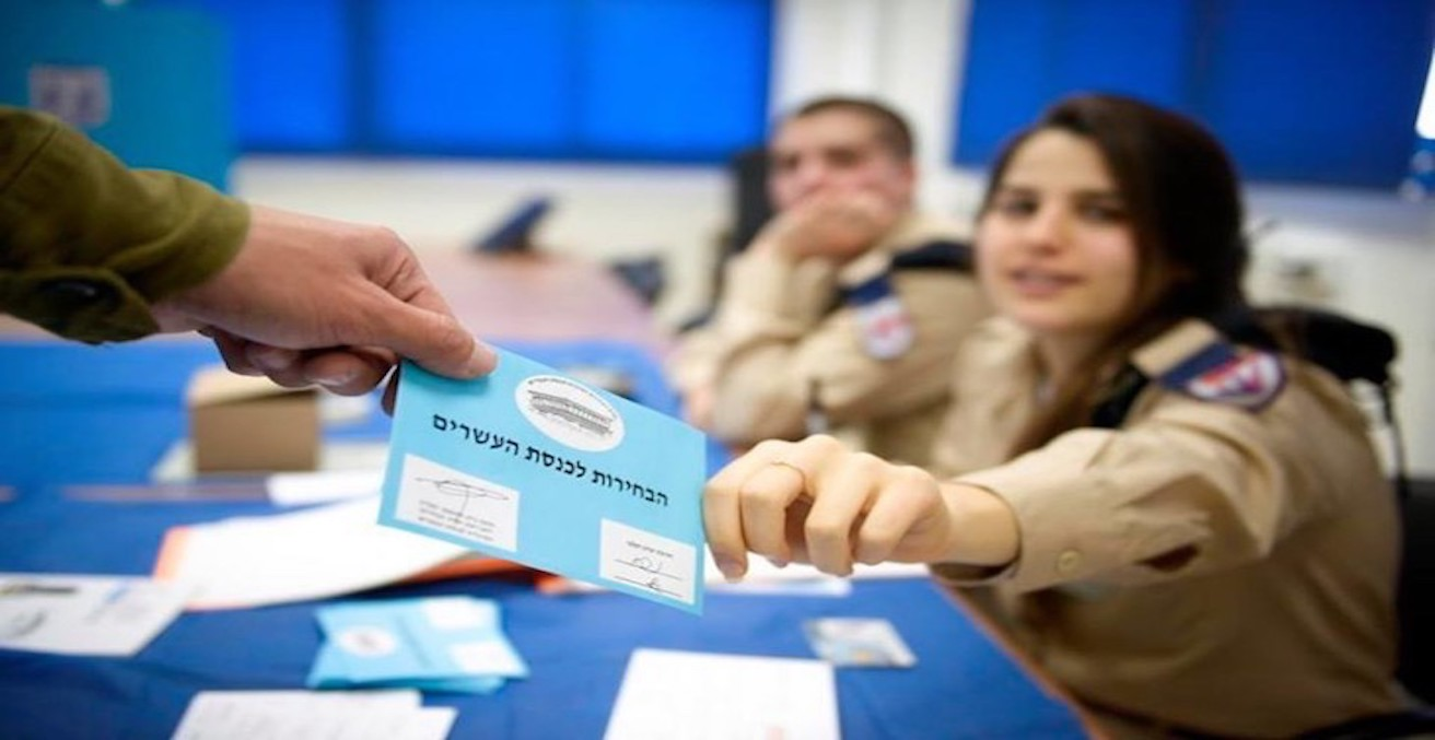 Members of the Israeli Defense Forces voting during an election. Source: Flickr, Israel Defense Forces https://bit.ly/2GLBOxJ