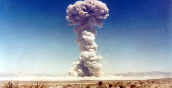 Military personnel observe a nuclear weapons test in Nevada, Source: International Campaign to Abolish Nuclear Weapons, Flickr, https://bit.ly/2ZfaNcp