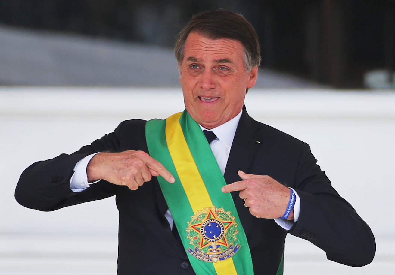 Brazil's President Jair Bolsonaro gestures after receiving the presidential sash, Source: Sergio Moraes, Flickr, https://bit.ly/2kv1Ih0