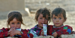 Iraqi Children Observe US Soldiers. Photo by Alan D. Monyelle, US Navy Photo, source: https://bit.ly/2O1oeKs