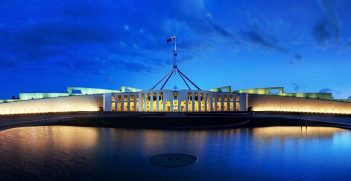 Parliament House at Dusk. photo by JJ Harrison, Wikimedia. Source: https://bit.ly/2PCT7FK