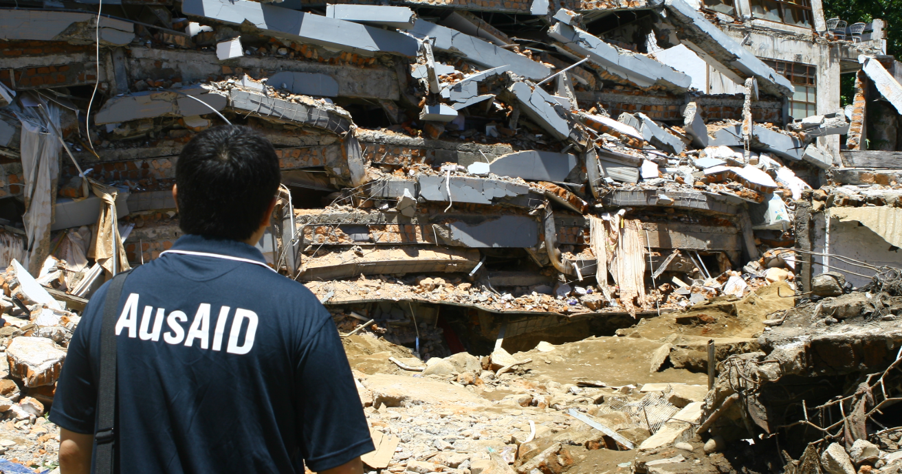 An AusAID staff member examines damage caused by a 7.6 magnitude earthquake in Padang, Indonesia. Australia and Indonesia are working together to improve infrastructure and reduce the risk and impact of natural disasters. Source: Department of Foreign Affairs and Trade, https://bit.ly/31P8y27