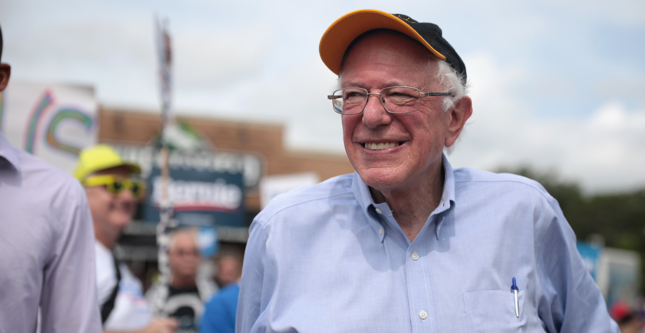 U.S. Senator Bernie Sanders walking in the Independence Day parade with supporters in Ames, Iowa. Source: Gage Skidmore https://bit.ly/384sZK9