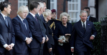 Prince Charles and Duchess of Cornwall, Camilla arrive to greet, Prime Minister David Cameron, U.S. Ambassador Louis Susman, Deputy Prime Minister Nick Clegg, Mayor of London Boris Johnson, and leader of the Labour party David Miliband as they attend the tenth anniversary ceremony to commemorate the attacks on the World Trade Centre in New York at the memorial near to the U.S. Embassy in London September 11, 2011. Source: Luke MacGregor Reuters https://bit.ly/37GSh0A