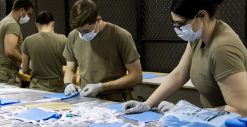 Parachute riggers with 1st Special Forces Group (Airborne), Group Support Battalion, sew surgical masks for medical patients at Joint Base Lewis-McChord, Wash., March 31, 2020. Source: Joe Parrish https://bit.ly/2UJw92k