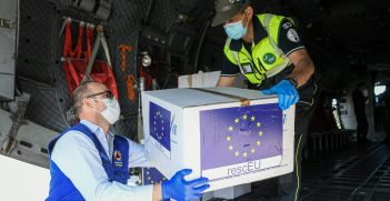 A box of masks is unloaded from a cargo plane in Milan, Italy. Source: European Union https://bit.ly/2AfHr6A