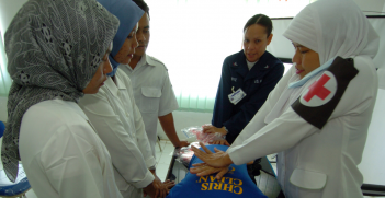 An Indonesian nurse practices CPR during a class taught by military members, assigned to the Military Sealift Command (MSC) hospital ship USNS Mercy (T-AH 19), at Tentera Nasional Indonesia Military Hospital in Banda Aceh, Indonesia. Source:  US Navy/Rebecca J. Moat https://bit.ly/3fjcuPf