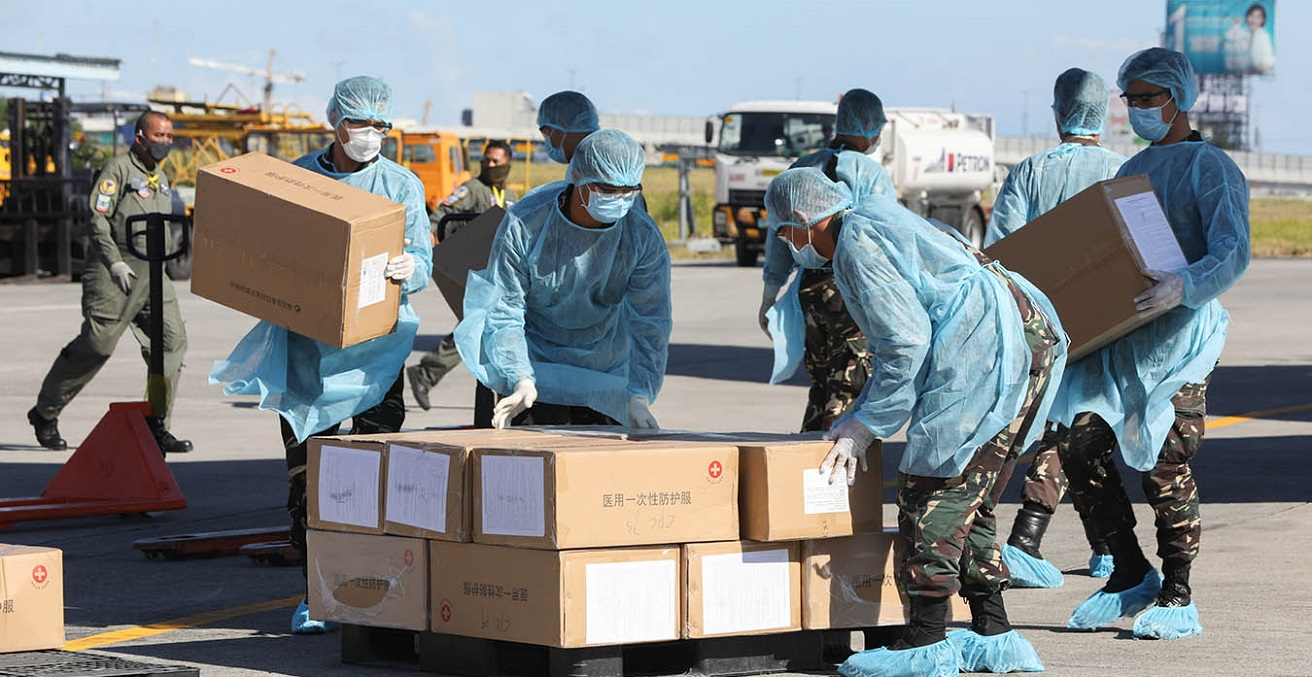 Aid packages donated by the People's Republic of China are unloaded at the Villamor Air Base in Pasay City, Philippines. The donation includes assorted medical supplies, personal protective equipment, and testing kits for coronavirus. Source: Toto Lozano https://bit.ly/3cqN546