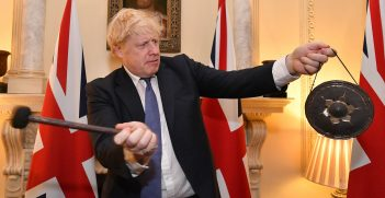 Britain's Prime Minister Boris Johnson inside No10 Downing street striking a gong at 11pm the moment the UK left the EU. Source: Andrew Parsons/No10 Downing Street https://bit.ly/2YynVuF
