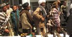 Former Taliban fighters line up to handover their Rifles to the Government of the Islamic Republic of Afghanistan during a reintegration ceremony at the provincial governor's compound. Source: Department of Defense, Lt. j. g. Joe Painter https://bit.ly/3eUIbgY