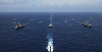 USS KITTY HAWK, At sea (Sept. 5, 2007) Naval ships from India, Australia, Japan, Singapore, and the United States steam in formation in the Bay of Bengal during Exercise Malabar. Source: Mass Communication Specialist Seaman Stephen W. Rowe https://bit.ly/2BOaP5o