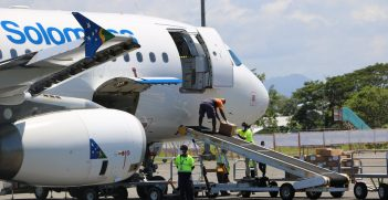Baggage handlers unload Australian funded COVID-19 response supplies in Solomon Islands Source: Department of Foreign Affairs and Trade, https://bit.ly/3kDGPd4