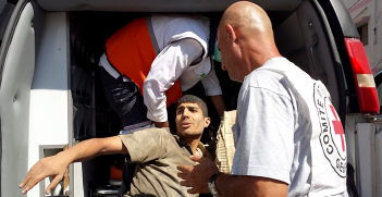 Source: ICRC (Shujaia, Gaza. ICRC staff transfer a casualty to an ambulance for evacuation)