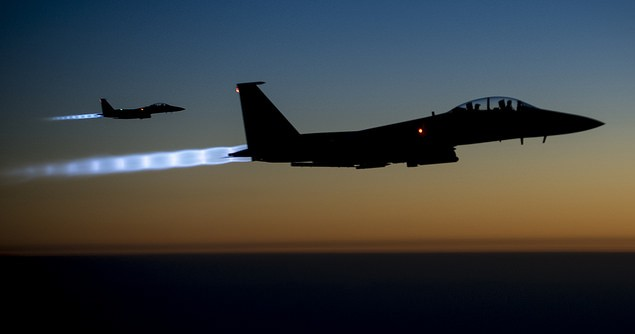 Two U.S. Air Force F-15E Strike Eagle aircraft fly over northern Iraq Sept. 23, 2014, after conducting airstrikes in Syria. Image credit: Flickr (US Department of Defence)