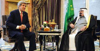 U.S. Secretary of State John Kerry speaks with Saudi Arabia's King Abdullah before their meeting at his desert encampment Rawdat Khuraim on January 5, 2014. Image credit: Flickr (US Department of State)