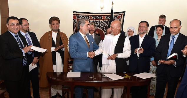Afghan Presidential Candidates Abdullah and Ghani Shake Hands After Signing Joint Declaration of the Electoral Teams. Image credit: Flickr (US Embassy Kabul Afghanistan)