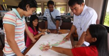 Local officials discuss the hazard map prepared by GGGI through the Ecotown Project in the Philippines.  The final report is available here (http://gggi.org/wp-content/uploads/2014/04/Eco_Town_Framework.pdf) Image Credit: Global Green Growth Institute (GGGI)