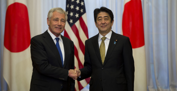 Former Secretary of Defense Chuck Hagel greets Japanese Prime Minister Shinzo Abe in 2014. Image credit: Flickr (Ash Carter) Creative Commons.